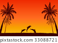 Silhouette jumping dolphin and palm tree at sunset 33088721