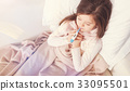 Poor little girl holding thermometer in her mouth 33095501