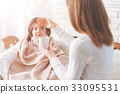 Kind woman treating her ill child 33095531