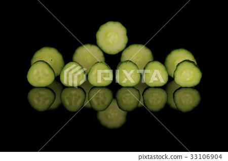 Cucumber slice black background 33106904