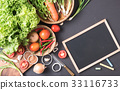 mix vegetable with blackboard on black background 33116733