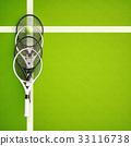 Tennis,rackets,near,a,yellow,ball,on,a,green,court 33116738