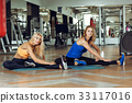 two young slender blond women doing exercises in 33117016