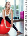 Young athletic woman doing exercises with fitness 33117211