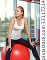 Young athletic woman doing exercises with fitness 33117214