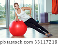 Young athletic woman doing exercises with fitness 33117219