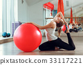 Young athletic woman doing exercises with fitness 33117221