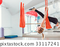 Fly yoga. Young woman practices aerial anti 33117241