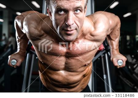Brutal caucasian handsome fitness men on diet training chest pum 33118486