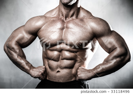 Caucasian sexy fitness model in gym close up abs. 33118496