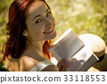 Close up portrait of red haired lady on nature 33118553
