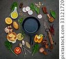 Italian food cooking ingredients on dark stone. 33121720