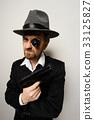 crazy beard detective whit gun in hat 33125827