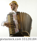 Portrait of professional musician with accordion 33126184