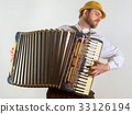 Portrait of man in straw hat playing on accordion 33126194