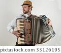 accordion musician playing 33126195