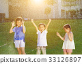 Happy kids has fun playing in water fountains 33126897