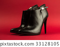 high heel black shoes on red background 33128105