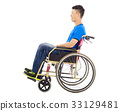 hopeful young man sitting on  wheelchair  33129481