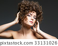 beautiful girl with curly hairdo 33131026