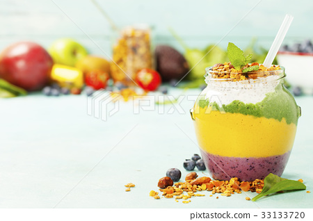 Freshly blended fruit smoothie in glass jar  33133720