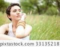 cute girl on green field 33135218