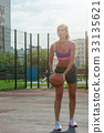 woman in sportswear with basketball ball 33135621