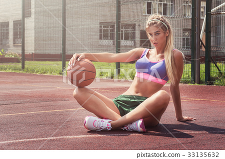 woman in sportswear with basketball ball 33135632