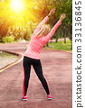Fitness woman runner stretching before jogging 33136845
