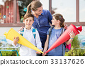 Mother and children on first day of school with 33137626