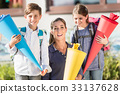 Mother and children on first day of school with 33137628