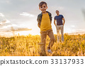 Cheerful kid enjoying nature with his dad 33137933