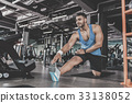 Satisfied bearded athlete taking physical exercise 33138052