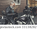 Attentive old man keeping bike slam 33138282