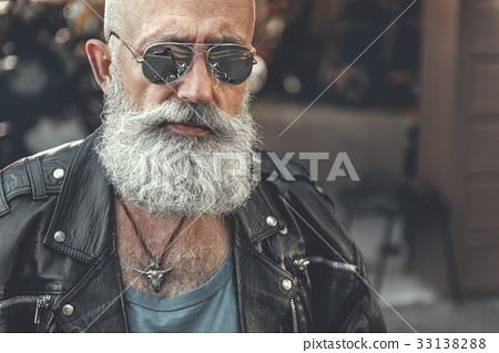 Confident bearded man near garage 33138288