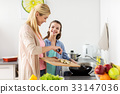 happy family cooking food at home kitchen 33147036