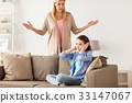 girl closing ears to not hear angry mother at home 33147067