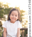 happy Asian child on a seesaw in sunset light 33147348
