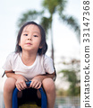 happy Asian child on a seesaw in sunset light 33147368