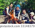 happy family roasting marshmallow over campfire 33148379