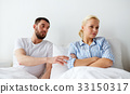 unhappy couple having conflict in bed at home 33150317
