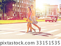 teenage couple with skateboards on city street 33151535