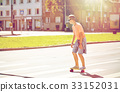teenage boy on skateboard crossing city crosswalk 33152031