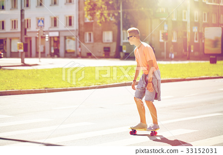 teenage boy on skateboard crossing city crosswalk 33152031
