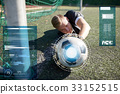 goalkeeper with ball at football goal on field 33152515