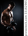 Athletic male with dumbbells 33162965