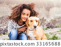 African american girl with her dog against 33165688