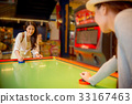 travelers standing front of the table hockey 33167463