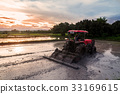 agriculture rice field countryside with Tractor 33169615