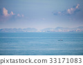 Speedboats sail the industrial coast. 33171083